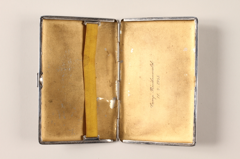 2001.236.1 open Cigarette case engraved with Camp Buchenwald