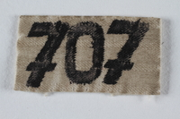 2001.254.3.1 front Numbered badge from a concentration camp prisoner's uniform  Click to enlarge