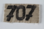 Numbered badge from a concentration camp prisoner's uniform