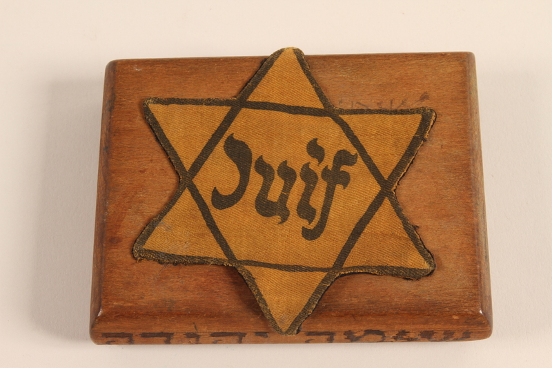 2001.299.1 top Hand carved cigarette case stamped with a Star of David