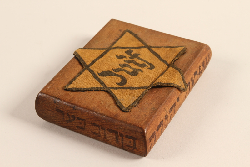 2001.299.1 left side Hand carved cigarette case stamped with a Star of David