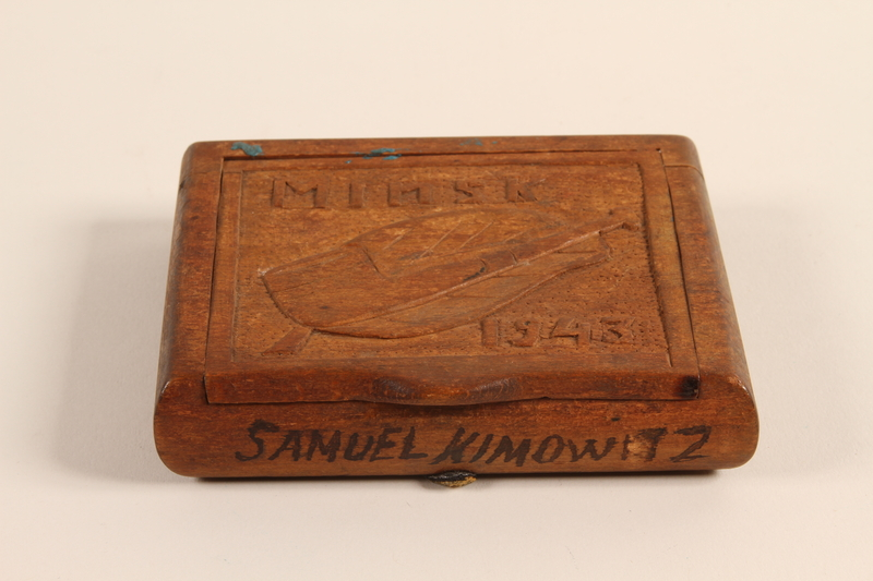 2001.299.1 bottom Hand carved cigarette case stamped with a Star of David