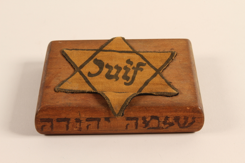 2001.299.1 other Hand carved cigarette case stamped with a Star of David