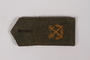 Olive shoulder board with gold crossed swords acquired by US soldier