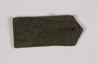 2014.480.64 back Olive shoulder board with gold crossed swords acquired by US soldier  Click to enlarge