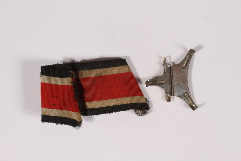 2014.480.9 a-b front German Iron Cross ribbon with pin acquired by an American soldier