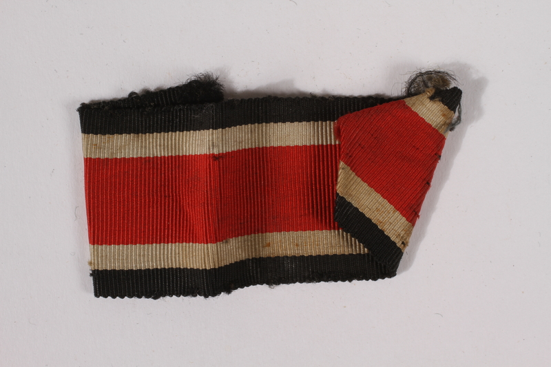 2014.480.9 b front German Iron Cross ribbon with pin acquired by an American soldier