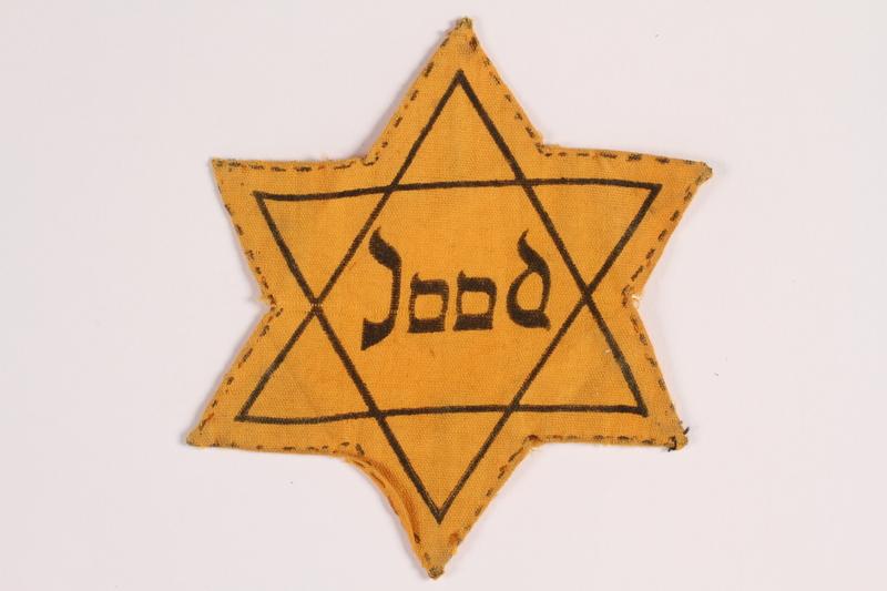 2012.487.2 front Star of David badge