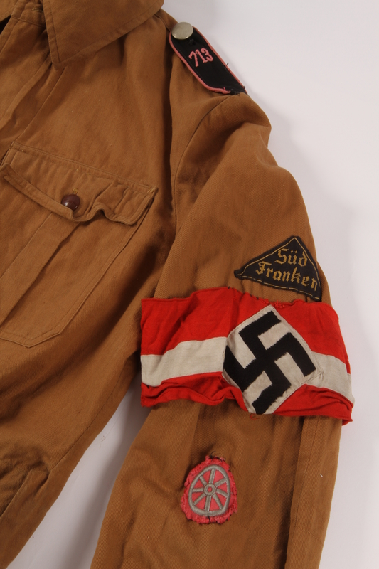 2013.512.2 detail Hitler Youth jacket with insignia and armband found by a US soldier