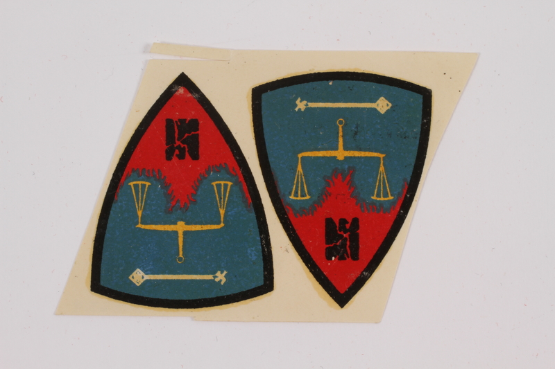 2015.163.4 front Nuremburg trial decals acquired by a US soldier attending the War Crimes Trials