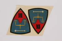 2015.163.4 front Nuremburg trial decals acquired by a US soldier attending the War Crimes Trials  Click to enlarge