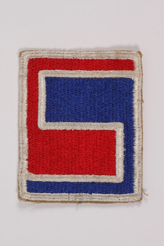 2015.163.6 front US Army patch acquired by a US soldier attending the War Crimes Trials