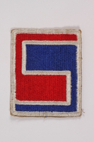 2015.163.6 front US Army patch acquired by a US soldier attending the War Crimes Trials  Click to enlarge