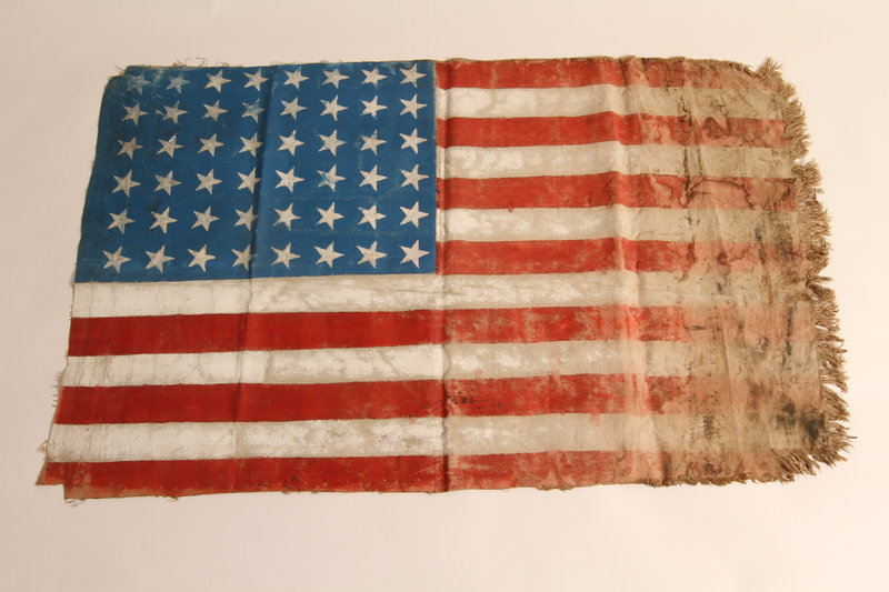 2015.450.1 front Handmade American flag created by former concentration camp inmates and given to a U.S. liberator