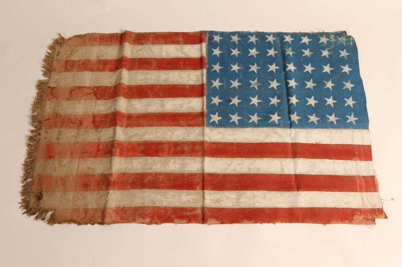 2015.450.1 back Handmade American flag created by former concentration camp inmates and given to a U.S. liberator