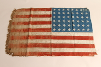 2015.450.1 back Handmade American flag created by former concentration camp inmates and given to a U.S. liberator  Click to enlarge