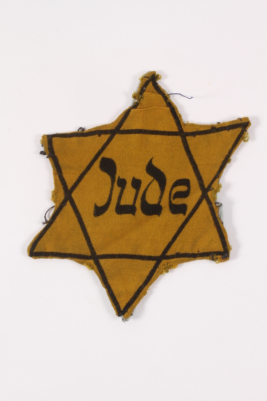 2013.515.2 front Star of David badge with Jude worn by Austrian Jewish woman