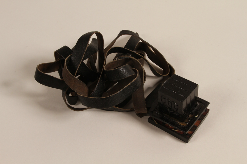 1988.118.1 c front Tefillin set found on the body of a concentration camp inmate by a Jewish American soldier