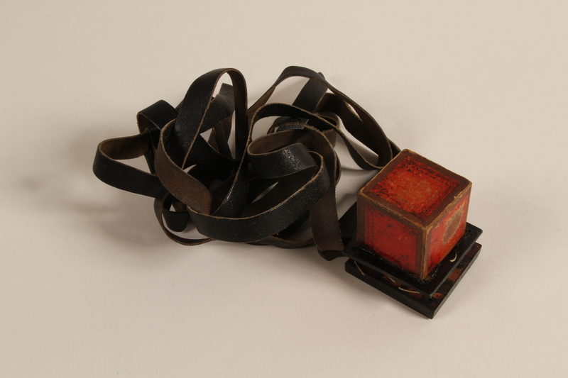 1988.118.1 b-c front Tefillin set found on the body of a concentration camp inmate by a Jewish American soldier