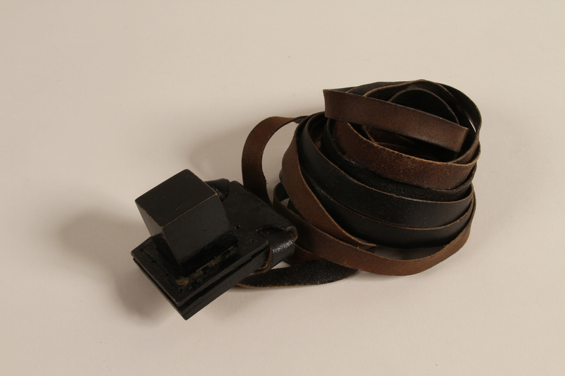 1988.118.1 e front Tefillin set found on the body of a concentration camp inmate by a Jewish American soldier