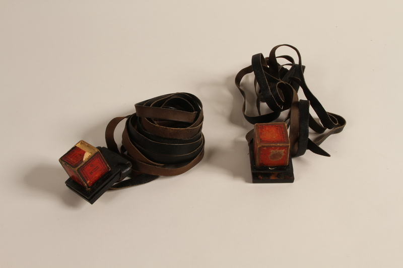 1988.118.1 b-e front Tefillin set found on the body of a concentration camp inmate by a Jewish American soldier