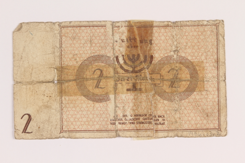 1986.33.2 back Łódź (Litzmannstadt) ghetto scrip, 2 mark note, found postwar