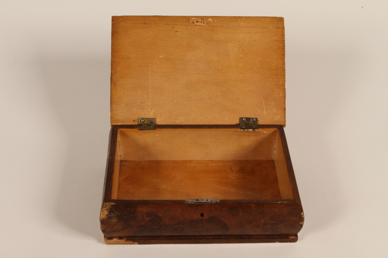 1991.162.1 open Wooden box with a decorative inlay of a figure