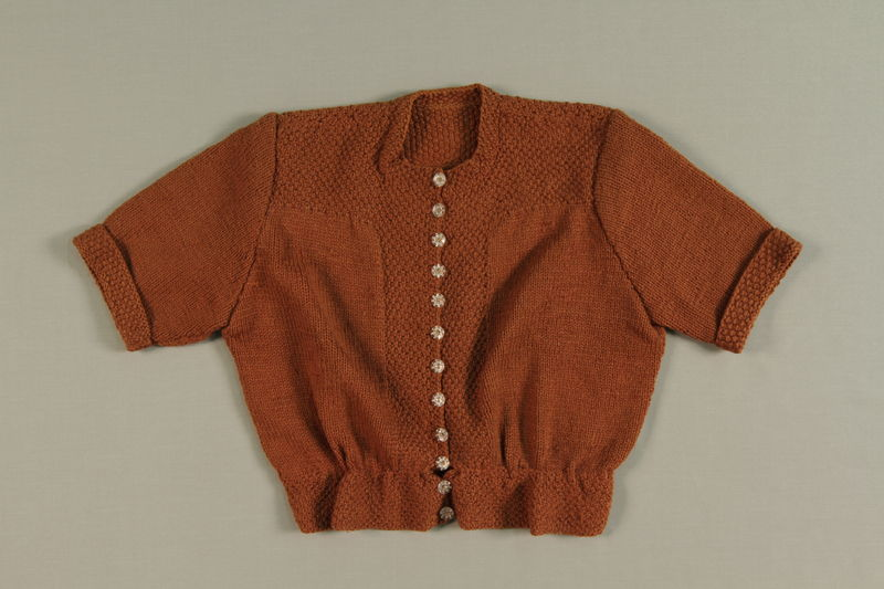 1990.101.1 front Hand knitted wool sweater made after liberation from donated materials