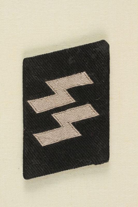 1990.107.86 front SS uniform collar tab found at Dachau by an American soldier