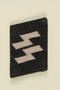 SS uniform collar tab found at Dachau by an American soldier
