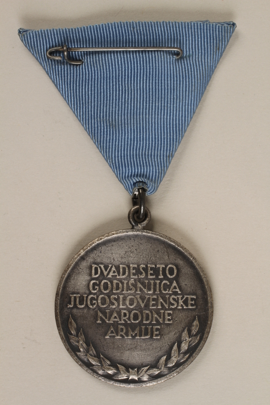 1990.118.16 back Medal for service as a Yugoslav partisan fighter