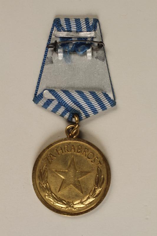 1990.118.17 back Medal for service as a Yugoslav partisan fighter