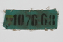 Green prisoner badge with the number 107668