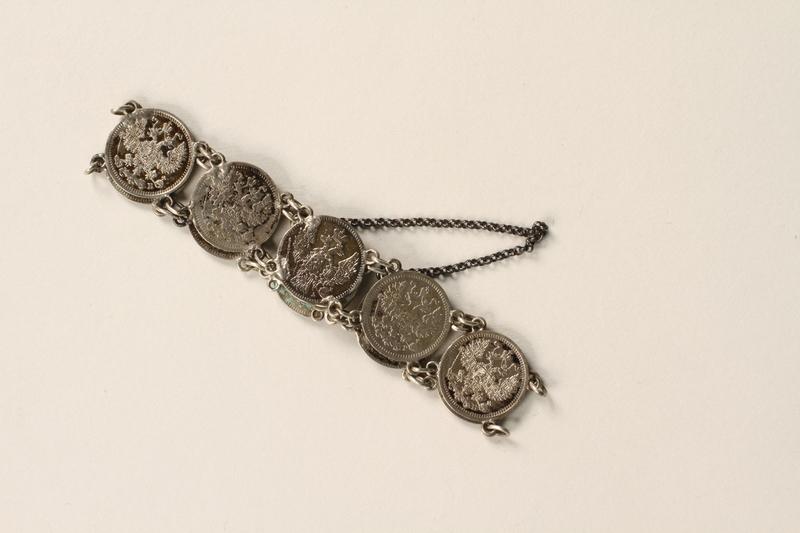1990.121.1 front Silver coin bracelet worn by a German Sinti woman