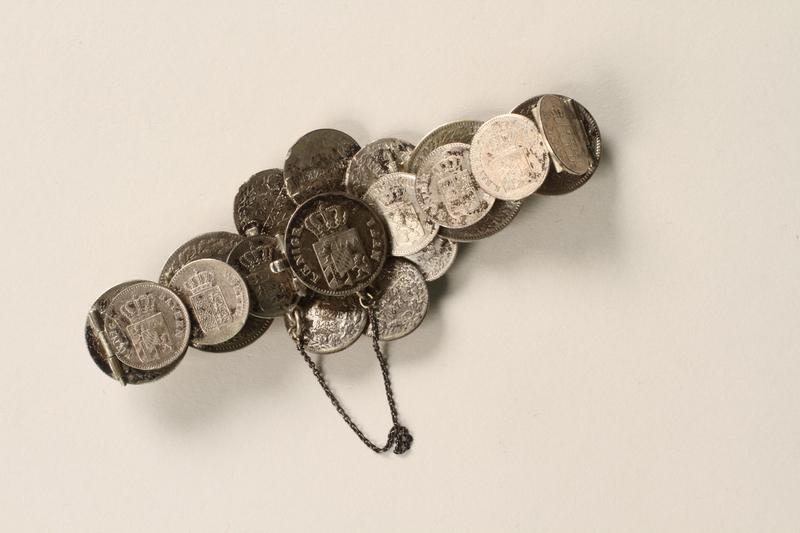 1990.121.2 back Silver coin bracelet worn by a German Sinti woman