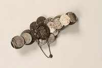 1990.121.2 back Silver coin bracelet worn by a German Sinti woman  Click to enlarge