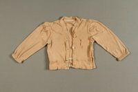 1990.144.17_a front Child's pajamas made from a nightgown in the Warsaw ghetto  Click to enlarge