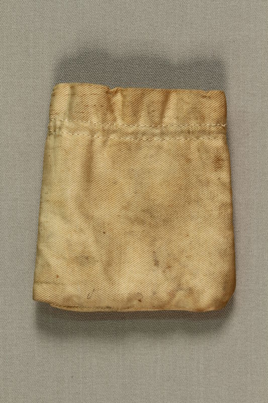 1990.150.1 front Small tan cloth bag found at Dachau after the war by a US soldier
