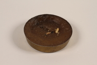 1990.150.3 front Small candle found at Dachau concentration camp after the war by a US soldier  Click to enlarge