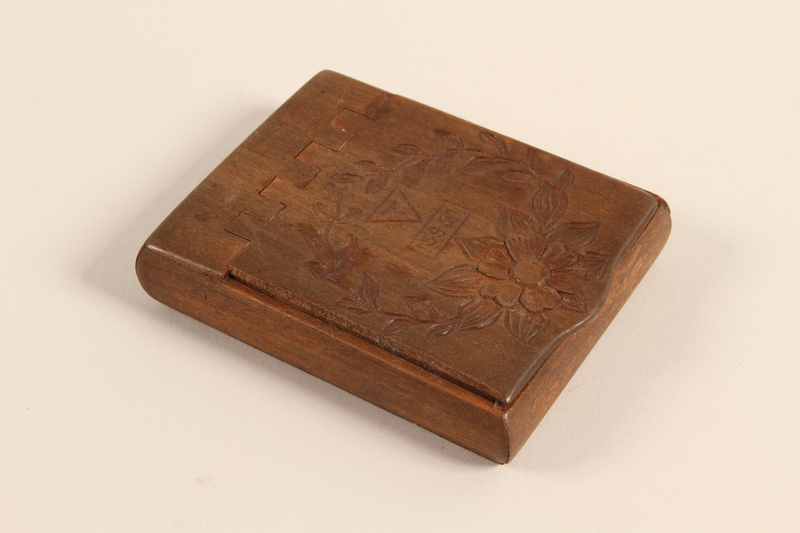 1990.161.1 front Wooden cigarette case made in Buchenwald