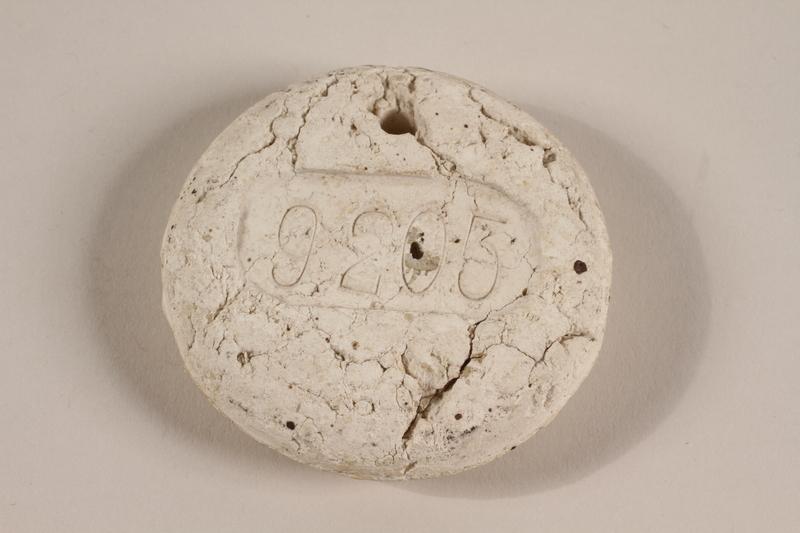 1990.178.1 front Crematorium tag