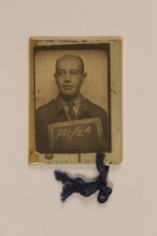 1999.106.24 back Prisoner badge