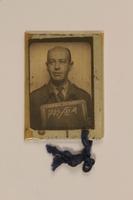 1999.106.24 back Prisoner badge  Click to enlarge