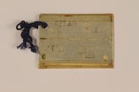 1999.106.24 front Prisoner badge  Click to enlarge