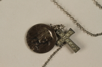 1990.210.2 front Necklace with two pendants, a cross and the Virgin Mary  Click to enlarge