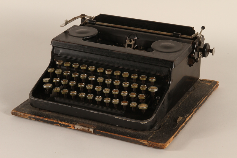 1990.213.1_a front Black metal typewriter with case used by a Hungarian rescuer to forge documents