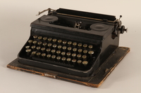 1990.213.1_a front Black metal typewriter with case used by a Hungarian rescuer to forge documents  Click to enlarge