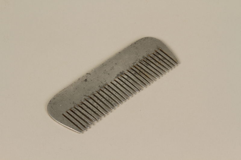 1990.220.1 front Comb made from airplane parts by a Polish Jewish female slave laborer