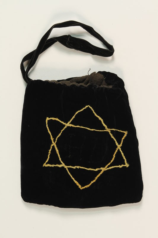 1990.223.1.2._a front Tefillin pair and embroidered pouch brought with a German Jewish refugee