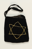1990.223.1.2._a front Tefillin pair and embroidered pouch brought with a German Jewish refugee  Click to enlarge